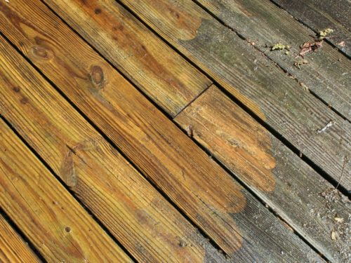 Wood deck cleaned with a pressure washer