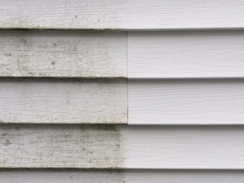 Siding cleaned with a pressure washer