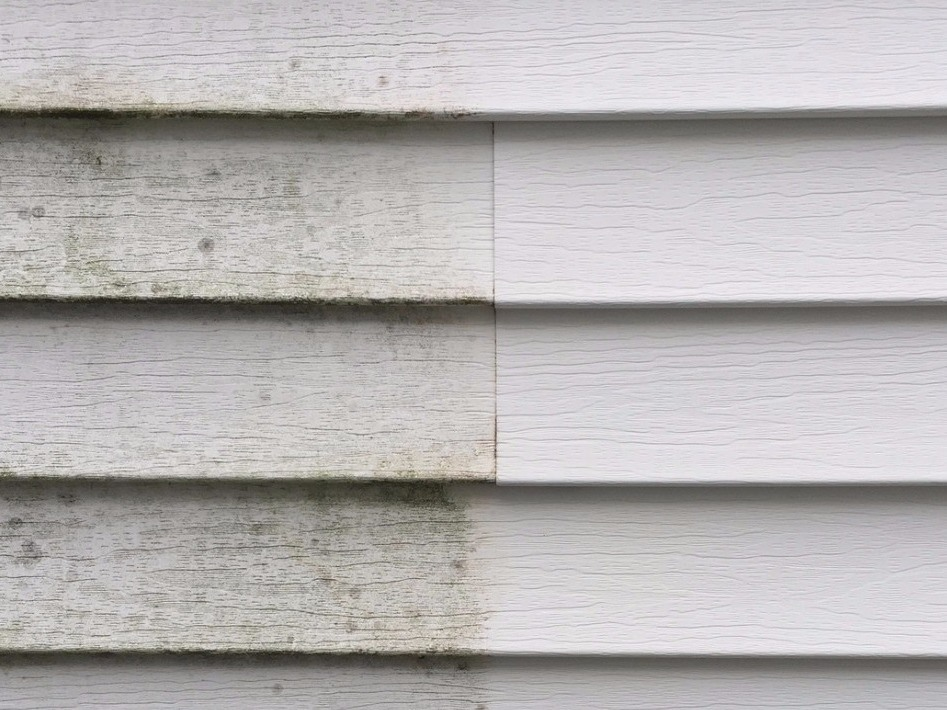 House siding cleaned with a pressure washer