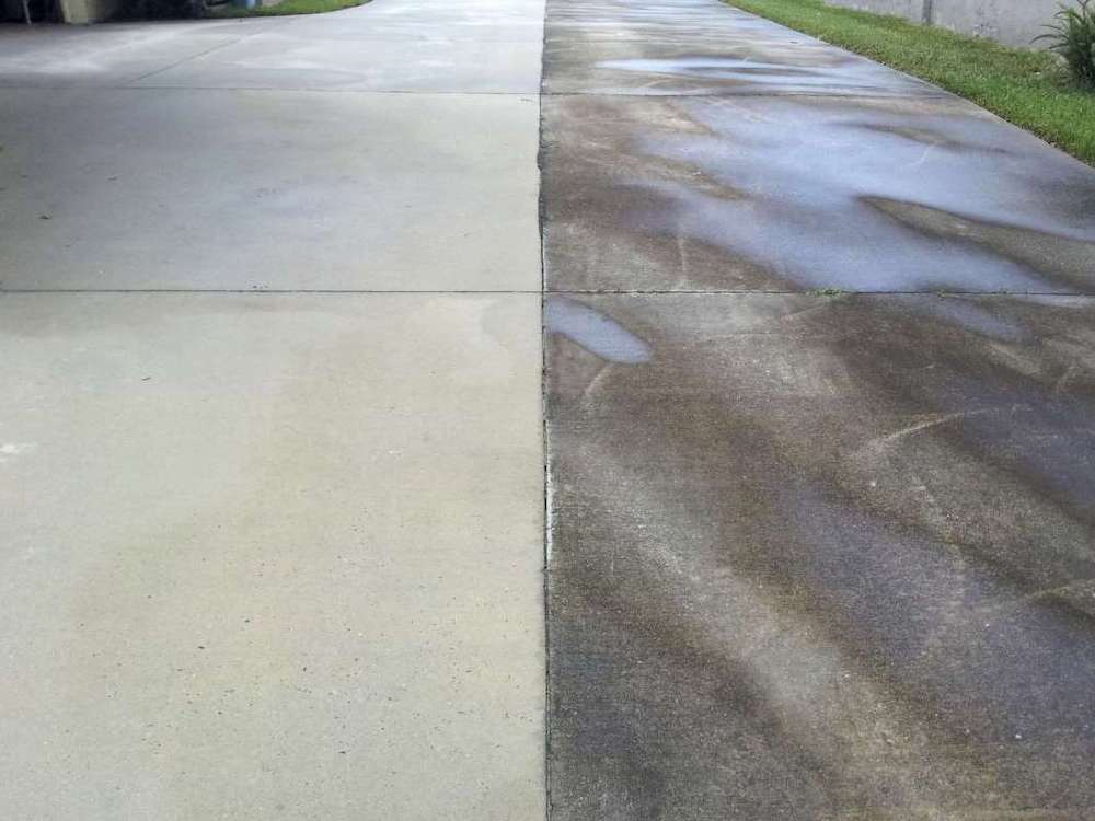 Concrete driveway cleaned with a pressure washer