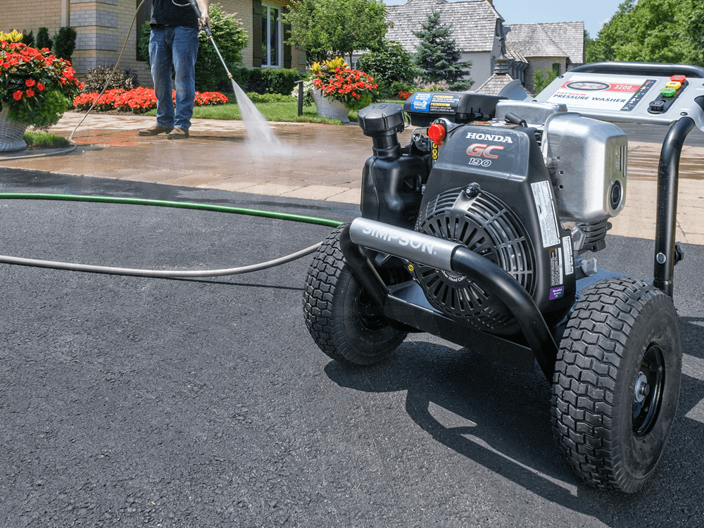 Man using the Simpson MSH3125-S gas pressure washer
