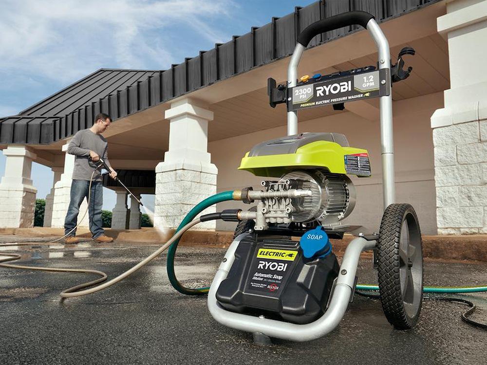 Man using the Ryobi RY142300 electric pressure washer