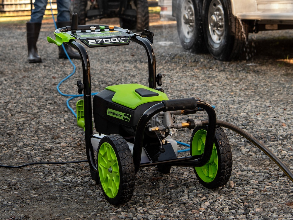 Man using the Greenworks GPW2700 electric pressure washer