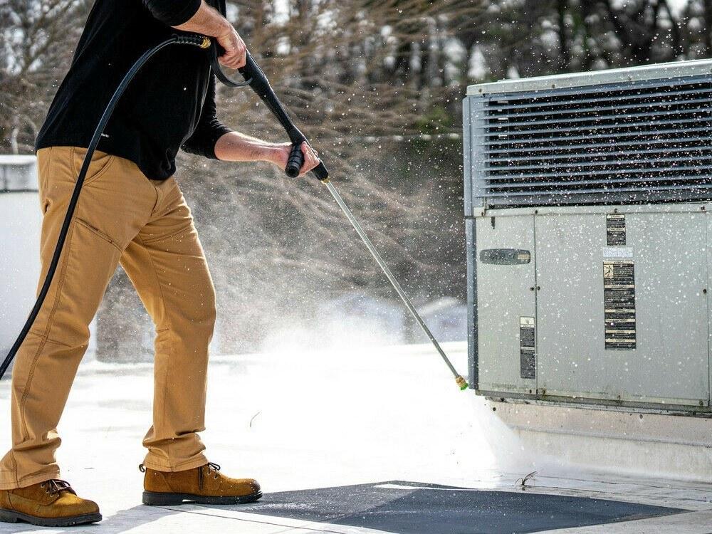 Man using the DeWalt DXPW60605 gas pressure washer