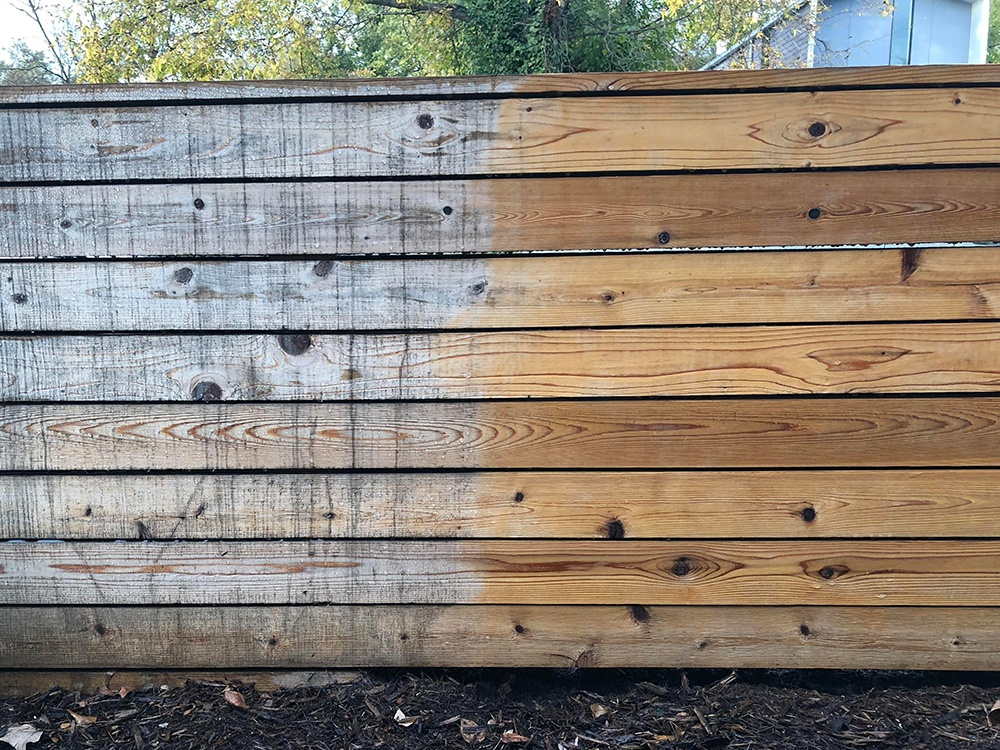 Wood fence before and after pressure washing